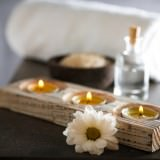 Composition of spa treatment on table colorful background