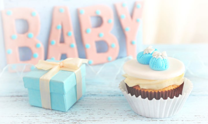 """Word """"Baby"""" with cupcake on bright background"""