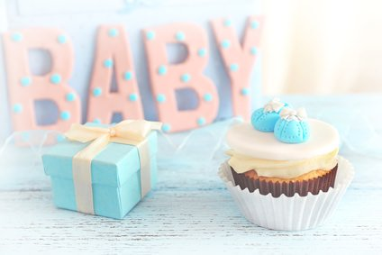 "Word ""Baby"" with cupcake on bright background"